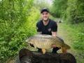 Luke with a stunning common carp